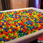 Man in ball pit photo booth