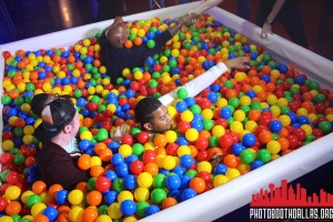 guys in ball pit photo booth for savor the sound